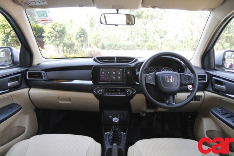 We compare the new Honda Amaze and the Maruti Suzuki Dzire on paper.