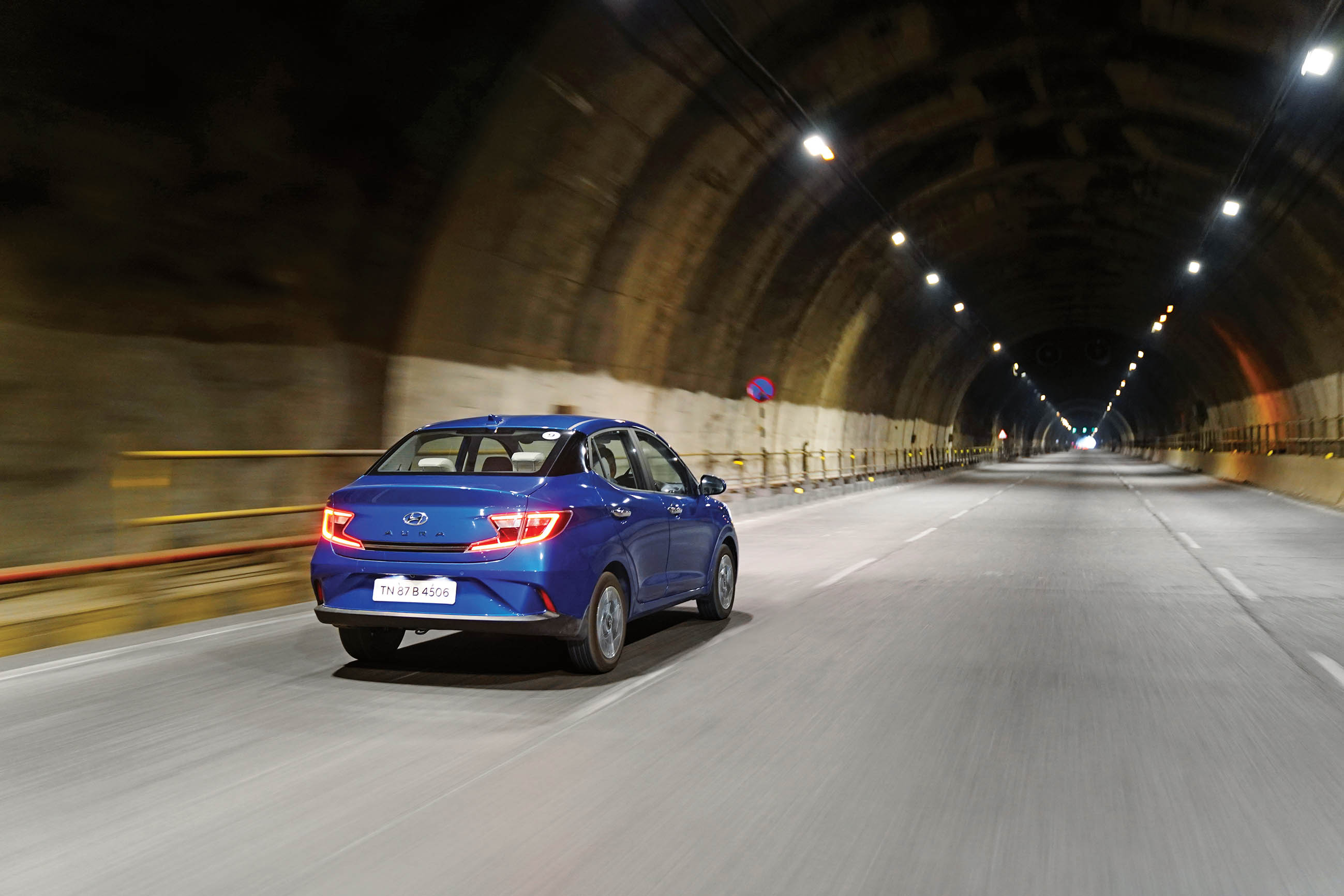 road test of the Hyundai Aura driving through a tunnel in India