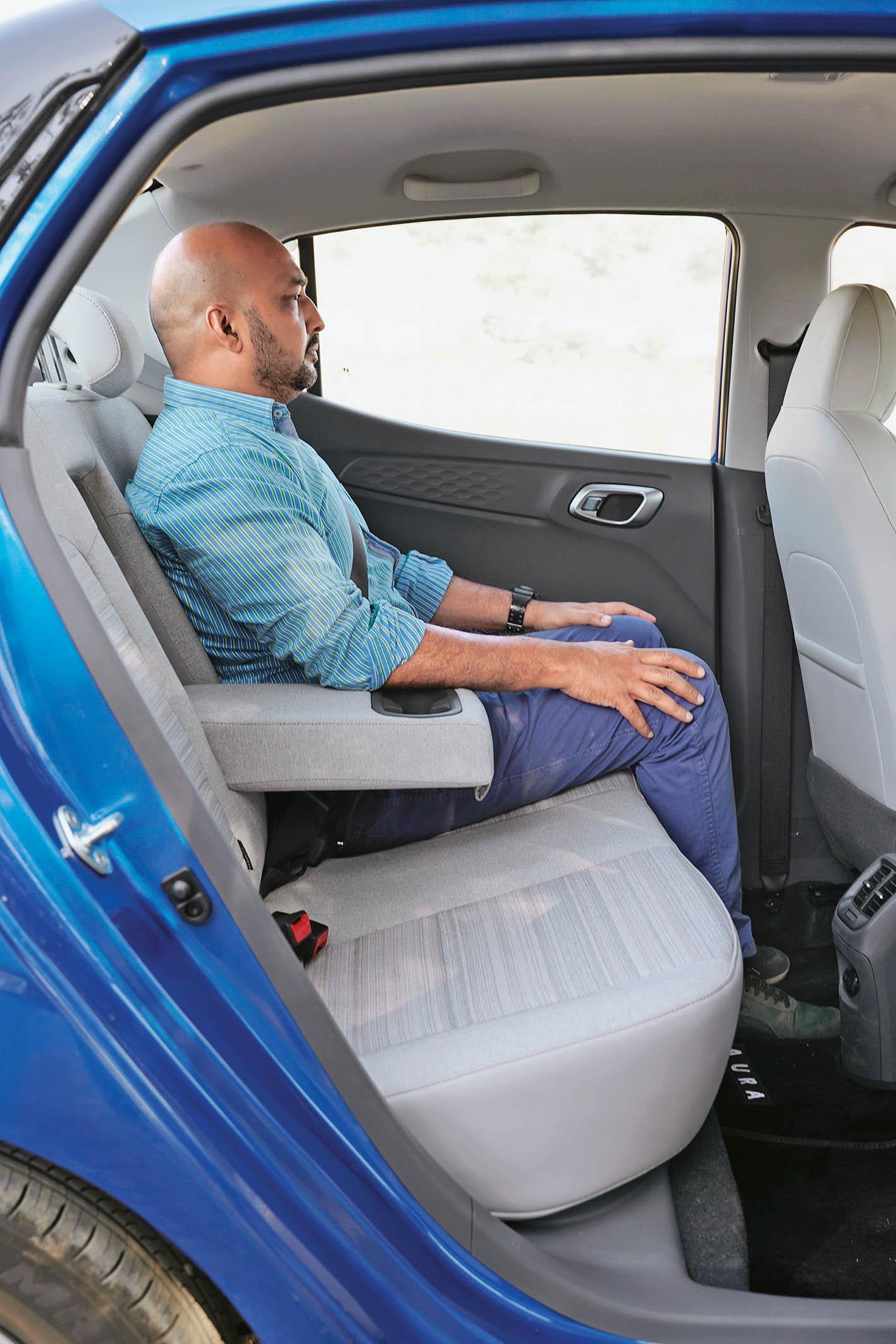 The back seat legroom of Hyundai Aura compact Sedan