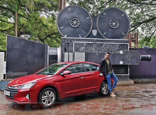 Raqesh Bapat poses with Hyundai Elantra sedan