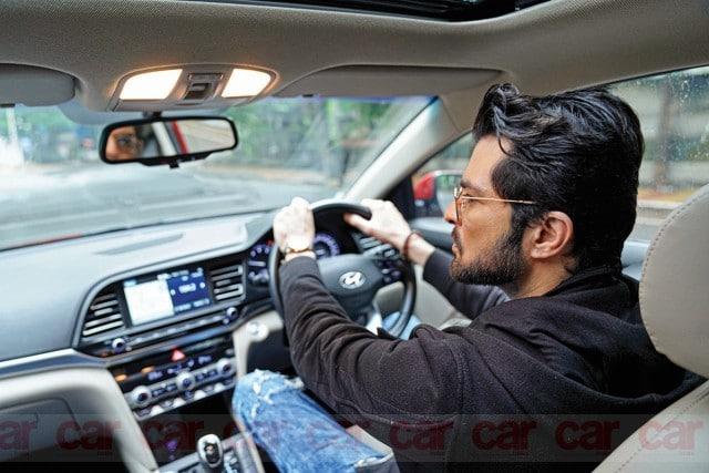Actor Raqesh Bapat driving a car